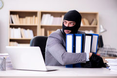 The criminal businessman wearing balaclava in office Royalty Free Stock Photography