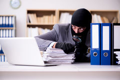 The criminal businessman wearing balaclava in office Stock Photography