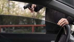 The criminal committed an armed robbery of the driver of the car. stock video