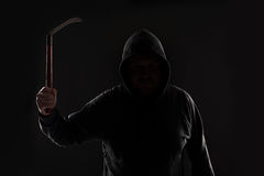 Criminal in dark clothes and balaclava with scythe royalty free stock photo