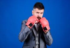 Criminal defense lawyer planning out strategies. Businessman wear boxing gloves. Best criminal defense lawyer strategies. Tactics proven to work. Attack and stock image