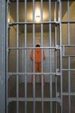 Criminal en celda de prisión Imágenes de archivo libres de regalías