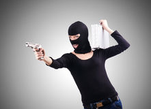 Criminal with gun isolated on the white Royalty Free Stock Image