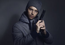 Criminal with gun Stock Photos
