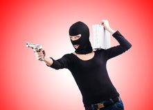 Criminal with gun  on the white Royalty Free Stock Photography