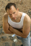 Criminal guy in undershirt Stock Photography
