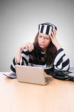 Criminal hacker with laptop against the gradient Royalty Free Stock Images