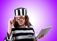 Criminal hacker with laptop against gradient Stock Photo