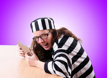 Criminal hacker with laptop against the gradient Stock Photos