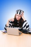 Criminal hacker with laptop on the white Royalty Free Stock Images
