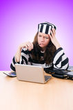 Criminal hacker with laptop on white Stock Photo