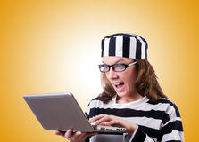 Criminal hacker with laptop on white Stock Images