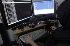 Criminal hacker penetrating networks Stock Photo