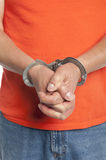 Criminal in handcuffs Stock Photo