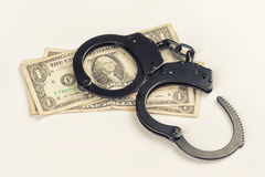 Criminal. Handcuffs on money. Stock Photo