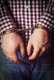 Criminal hands locked in handcuffs Royalty Free Stock Images