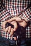 Criminal hands locked in handcuffs on dark background Stock Photo