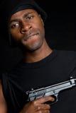 Criminal Holding Gun. Black gangster criminal holding gun Stock Photo