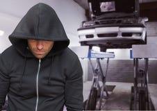 Criminal with hood in car theft mechanics fraud Stock Photography