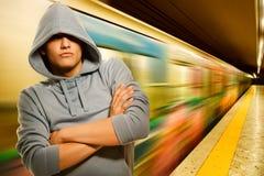 Criminal joven en subterráneo Imagenes de archivo