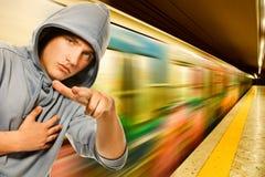 Criminal joven en subterráneo Foto de archivo libre de regalías