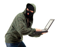 Criminal  with the laptop Stock Images