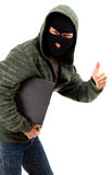 Criminal with the laptop, thumb up Royalty Free Stock Photo