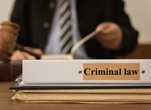 Criminal law. Closeup criminal law document folder with lawyer work at law firm. concept of criminal law Royalty Free Stock Image