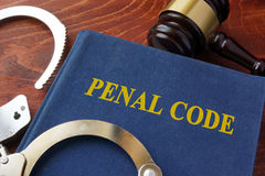 Criminal law concept. Cuffs and book with the title Penal code. Criminal law concept Royalty Free Stock Photos