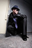 Criminal lurking. Suspicious criminal lurking in the alley at night stock photos