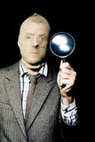 Criminal with magnifying glass Stock Photos