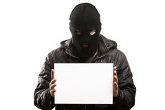 Criminal man in balaclava or mask covering face holding blank wh Stock Photos