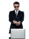 Criminal man computer hacker satisfied on phone Stock Photos