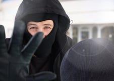 Criminal man exposed blocking camera. Digital composite of Criminal men exposed blocking camera Royalty Free Stock Image
