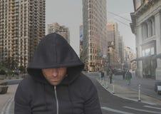 Criminal man on grey city street. Digital composite of Criminal man on grey city street Royalty Free Stock Photos