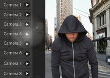 Criminal man on Security Camera App Interface street. Digital composite of Criminal man on Security Camera App Interface street Royalty Free Stock Photos