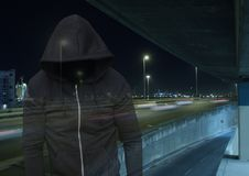 Criminal man transparent with night road car park. Digital composite of Criminal man transparent with night road car park Royalty Free Stock Photography
