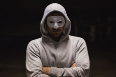 Criminal in mask looking at camera Stock Photos