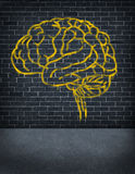 Criminal Mind. With a sprayed graffiti painting of a human brain on an old outdoor street brick wall as a health care and legal symbol of criminal behavior and Royalty Free Stock Image