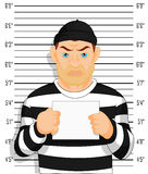 Criminal photo Caught criminal stands beside wall with number in hand Royalty Free Stock Photography