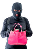 Criminal with a pink bag in search of valuable things. On a white background stock photo