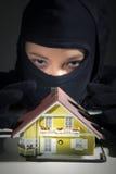 Criminal plans burglar in the house Stock Photos