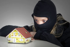 Criminal plans burglar in the house Royalty Free Stock Photo