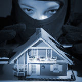 Criminal plans burglar in the house Stock Image
