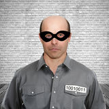Criminal in prison cell Stock Photography