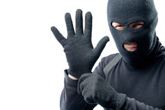 The criminal puts on a glove. Preparation for robbery Royalty Free Stock Photo