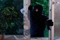 Criminal robs the house Stock Images