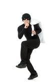 Criminal running away carrying a bag Stock Images