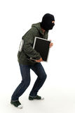 Criminal with the screen of computer Royalty Free Stock Photo