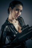 Criminal, Sexy girl military woman posing with guns. Stock Photography